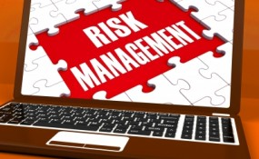 Risk Management On Laptop Showing Risky Analysis by Stuart Miles